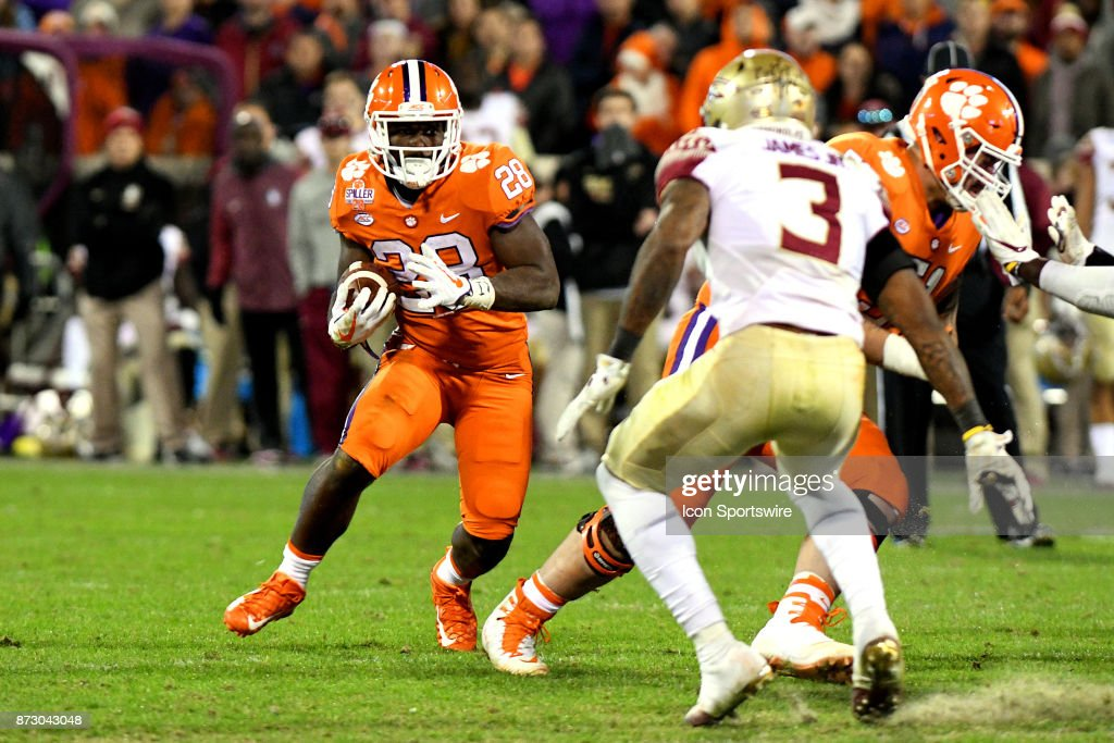 Clemson Tigers running back Tavien Feaster (28) tries to juke arons Florida State Seminoles defensive back Derwin James (3) during the game between the Florida State Seminoles and the Clemson Tigers on November 11, 2017, at Memorial Stadium in Clemson,SC.