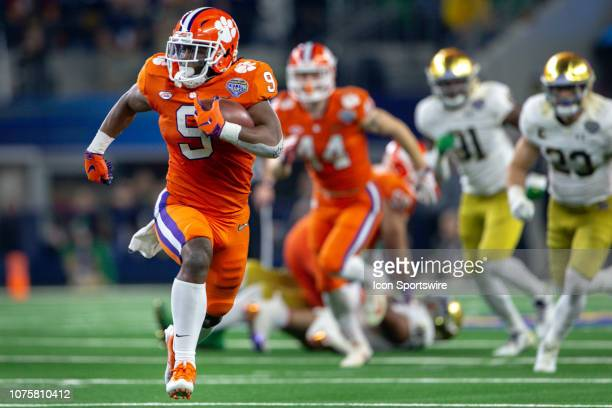 Clemson Tigers running back Travis Etienne heads to the end zone during the CFP Semifinal Cotton Bowl Classic game against the Notre Dame Fighting...