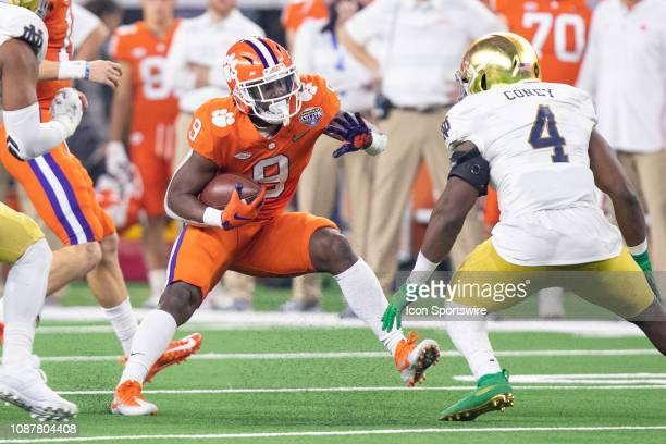 Clemson Tigers running back Travis Etienne makes a move as Notre Dame Fighting Irish linebacker Te'von Coney closes in during the Goodyear Cotton...
