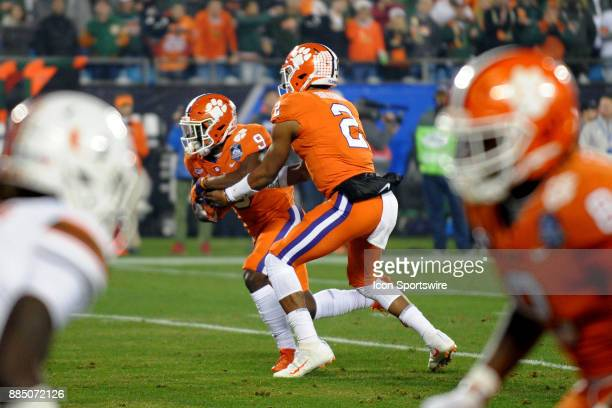 Clemson Tigers running back Travis Etienne takes tha hand off from Clemson Tigers quarterback Kelly Bryant during the ACC Championship game between...