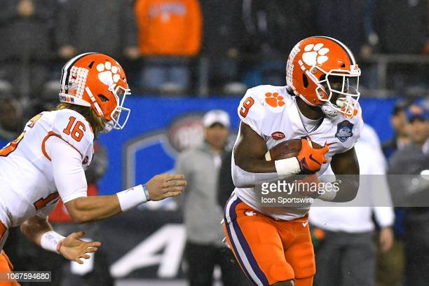 Clemson Tigers running back Travis Etienne takes the handoff and runs for a 75 yard touchdown in the ACC Championship game between the Pittsburgh...