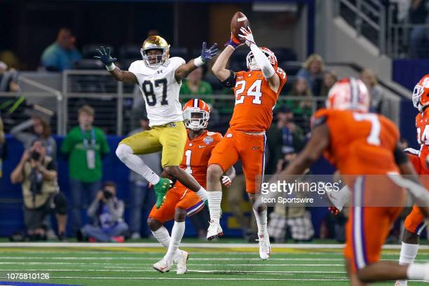 Clemson Tigers safety Nolan Turner intercepts a pass intended for Notre Dame Fighting Irish wide receiver Michael Young during the CFP Semifinal...