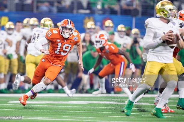 Clemson Tigers safety Tanner Muse closes in on Notre Dame Fighting Irish quarterback Ian Book during the Goodyear Cotton Bowl College Football...