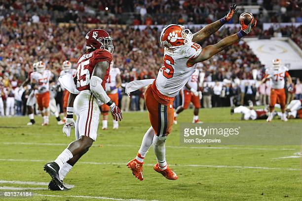 Clemson Tigers tight end Jordan Leggett catches a pass well being covered by Alabama Crimson Tide defensive back Ronnie Harrison for a first down in...