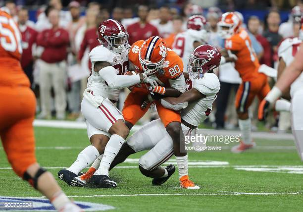 Clemson Tigers tight end Milan Richard catches a pass and is tackled by Alabama Crimson Tide linebackers Mack Wilson and Rashaan Evans during the...