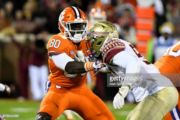 Clemson Tigers tight end Milan Richard goes head to head against Florida State Seminoles defensive end Brian Burns during the game between the...