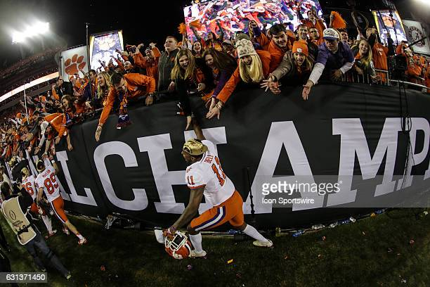 Clemson Tigers tight end Shadell Bell celebrates with fans after the College Football Playoff National Championship game between the Alabama Crimson...