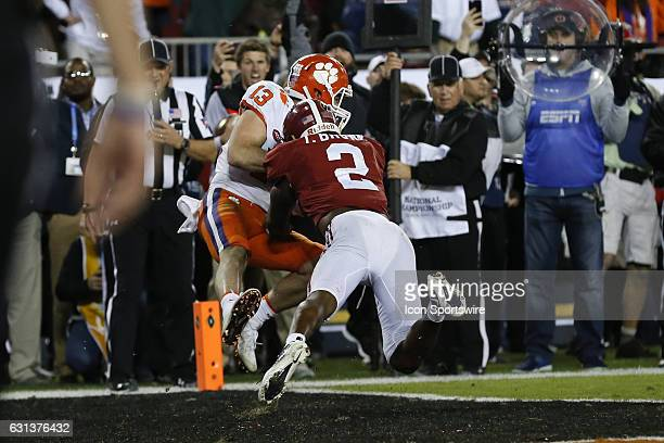 Clemson Tigers wide receiver Hunter Renfrow holds onto the ball well being hit by Alabama Crimson Tide defensive back Tony Brown for a touchdown with...
