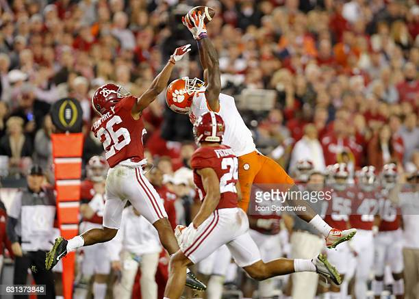 Clemson Tigers wide receiver Mike Williams leaps for a reception as Alabama Crimson Tide defensive back Marlon Humphrey and defensive back Minkah...