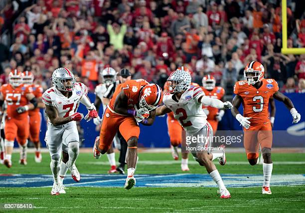 Clemson Tigers wide receiver Mike Williams stumbles allowing Ohio State Buckeyes safety Damon Webb and cornerback Marshon Lattimore to catch him...