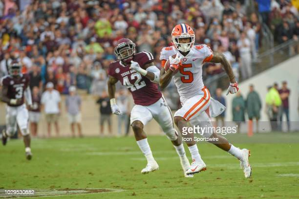 Clemson Tigers wide reciever Tee Higgins breaks free after his first half pass reception to score a long first half touchdown during the college...