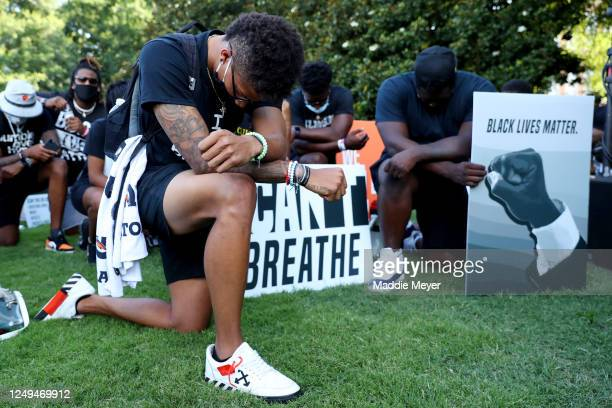 """Clemson University football players lead a """"March for Change"""" protest at Bowman Field on June 13, 2020 in Clemson, South Carolina. The protests were..."""