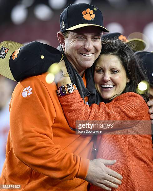 Clemson University head coach Dabo Swinney shares a special moment with his wife Kathleen during the award ceremony after the second half of the CFP...
