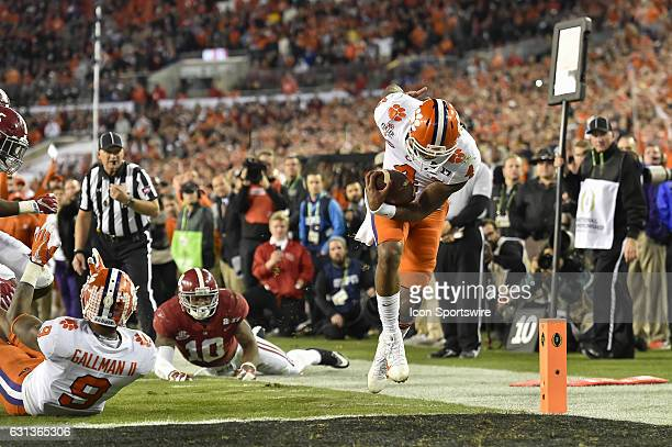 Clemson University quarterback Deshaun Watson runs in for a 8 yard touchdown during the first half of the CFP National Championship game between the...