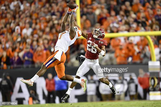 Clemson University wide receiver Mike Williams goes up high to catch a pass in front of University of Alabama defensive back Marlon Humphrey during...