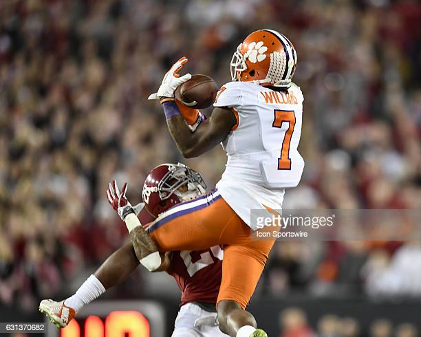 Clemson University wide receiver Mike Williams makes a crucial catch for a first down whiled defended by University of Alabama defensive back Anthony...
