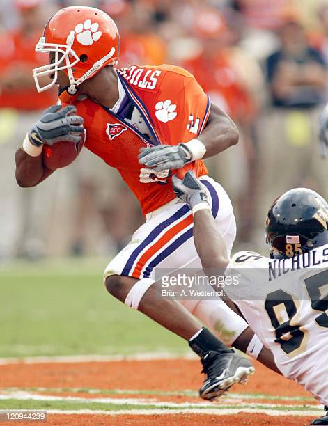 Clemson WR Chansi Stuckey tries to break free from the grasp of Wake Forest DT Jerome Nichols during second quarter action at Memorial Stadium in...