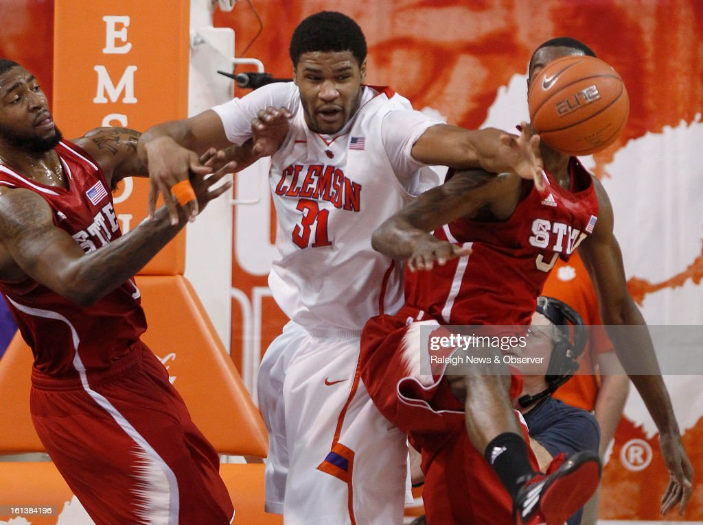 Clemson's Devin Booker (31), N.C. State's Richard Howell (1) and C.J. Leslie (5), right, fight for a rebound during the first half at Littlejohn Coliseum in Clemson, South Carolina, Sunday, February 10, 2013.