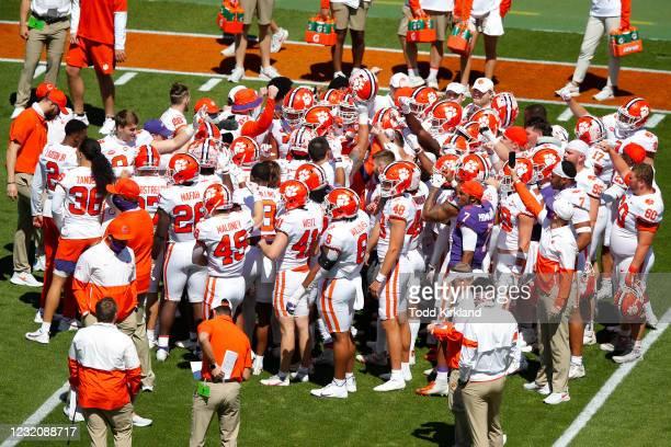Clemson's team white huddles up prior to the Clemson Orange and White Spring Game at Memorial Stadium on April 3, 2021 in Clemson, South Carolina.