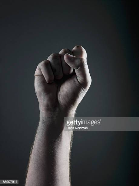 clenched fist - human arm stock pictures, royalty-free photos & images