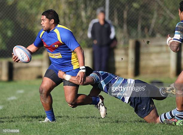 Clendon Pene of the Hornets looks to off load the ball during the Fox Memorial Championship match between the Otahuhu Leopards and Howick Hornets at...