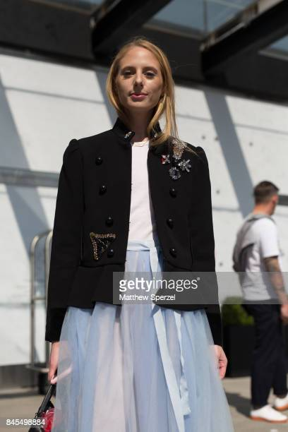 Cleo Davis is seen attending Public School during New York Fashion Week wearing a blazer with white top and blue tulle skirt on September 10 2017 in...