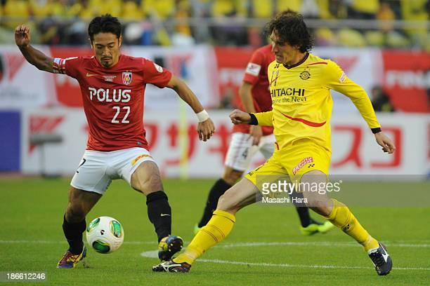 Cleo of Kashiwa Reysol and Yuki Abe of Urawa Red Diamonds compete for the ball during Yamazaki Nabisco Cup final match between Urawa Red Diamonds and...