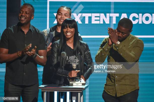 Cleopatra Bernard accepts an award on behalf of her son during the 2018 BET Hip Hop Awards at Fillmore Miami Beach on October 6 2018 in Miami Beach...