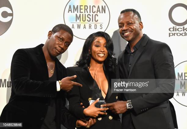 Cleopatra Bernard and guests who accepted the Favorite Album Soul/RB award for '17' on behalf of the late XXXTentacion pose in the press room during...