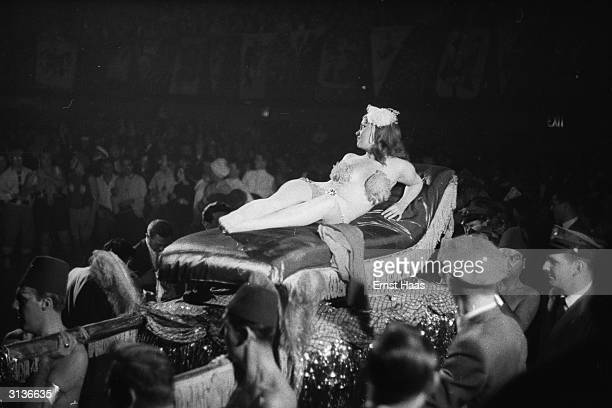 'Cleopatra' carried in to the Dream Ball an Arts Student League Ball held at the Plaza Hotel New York on a litter borne on the shoulders of fez...
