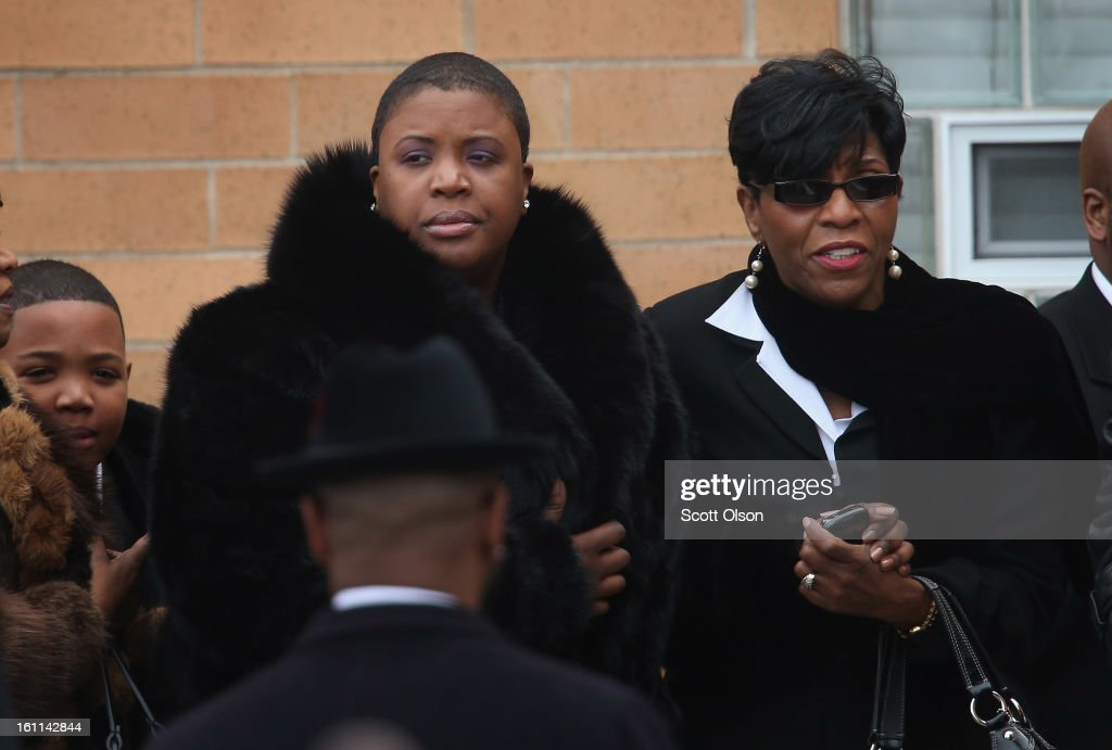 Cleopatra Pendleton (C) arrives with her son Nathaniel (L) for the funeral of her 15-year-old daughter Hadiya at the Greater Harvest M.B. Church on February 9, 2013, in Chicago, Illinois. Hadiya was killed on January 29, when a gunman opened fire on her and some friends while they were standing under a shelter on a warm rainy afternoon in a park about a mile from President Obama's Chicago home. First lady Michelle Obama attended the funeral with Senior White House Adviser Valerie Jarrett and Secretary of Education Arne Duncan.