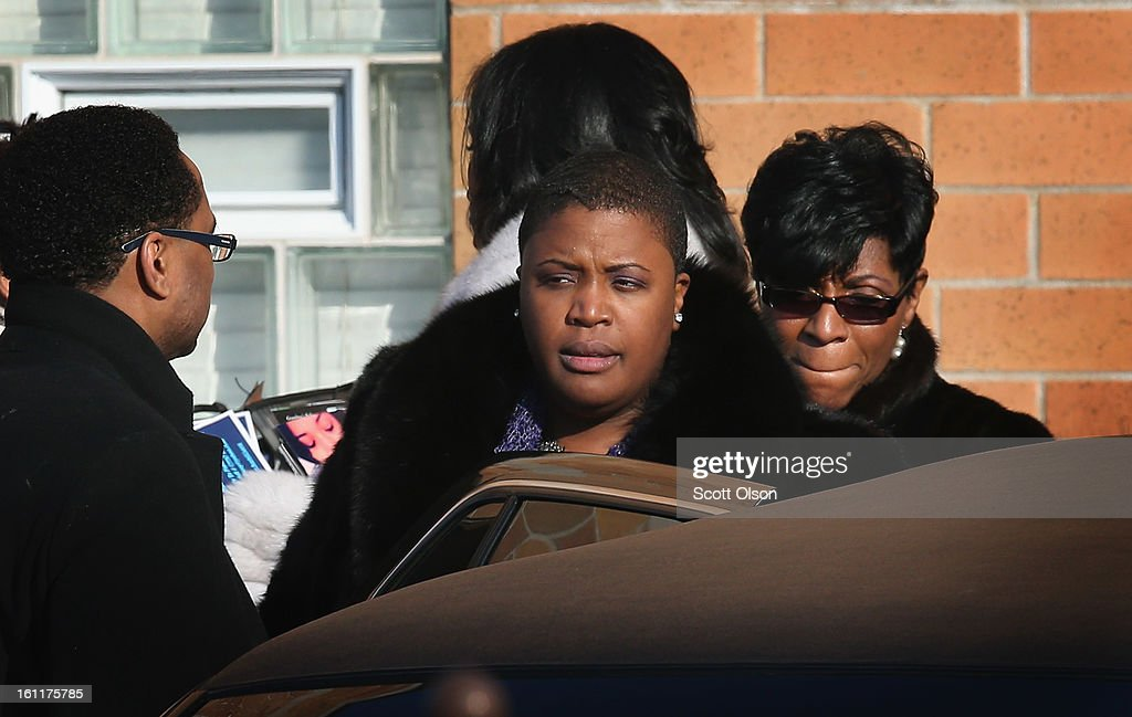 Cleopatra Pendleton (C) leaves the Greater Harvest M.B. Church following the funeral of her 15-year-old daughter Hadiya on February 9, 2013, in Chicago, Illinois. Hadiya was killed on January 29, when a gunman opened fire on her and some friends while they were standing under a shelter on a warm rainy afternoon in a park about a mile from President Obama's Chicago home. First lady Michelle Obama attended the funeral with Senior White House Adviser Valerie Jarrett and Secretary of Education Arne Duncan.