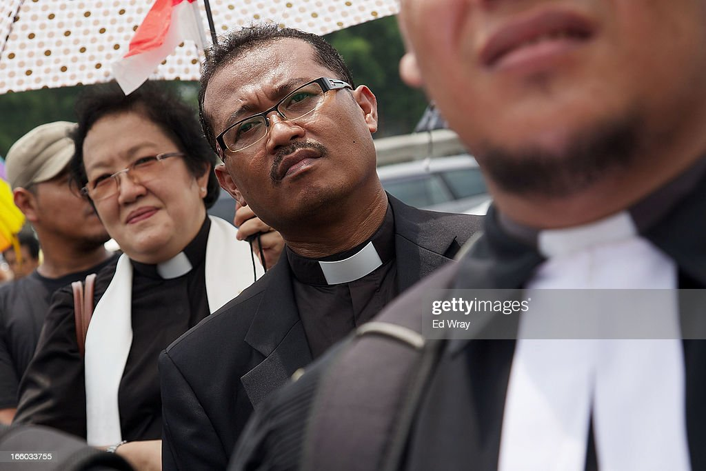 Clergy and leaders from Christian and Muslim religious minority groups march to the parliament to demonstrate for religious tolerance on the streets of Jakarta on April 8, 2013 in Jakarta, Indonesia. Recent reports suggest upwards of 260 violent attacks against religious minorities occured in 2012 in Indonesia.