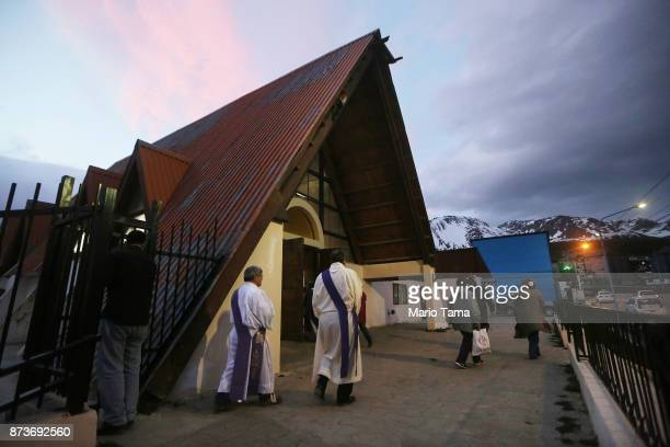 Clergy and parishioners walk after evening Mass on November 2 2017 in Ushuaia Argentina Ushuaia is situated along the southern edge of Tierra del...