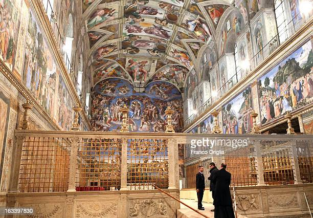 Clergy and workers make arrangements in the Sistine Chapel before the papal conclave on March 9 2013 in Vatican City Vatican Cardinals are set to...