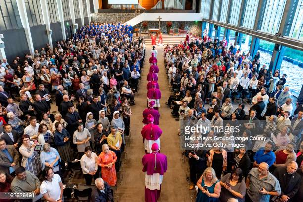 Clergy enter the arboretum at Christ Cathedral to begin a Solemn Evening Prayer and Vigil with the Relics at Christ Cathedral in Garden Grove on...