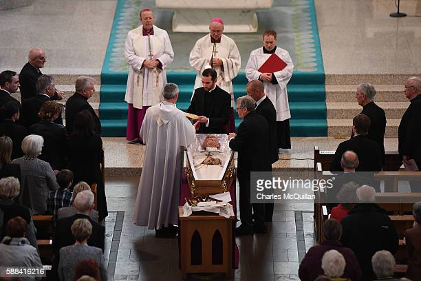 Clergy make final preparations for the funeral of the late retired Bishop of Derry Dr Edward Daly as he lies in state at St Eugene's Cathedral on...