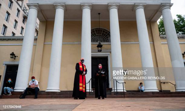 Clergy stand in front the St John's Episcopal Church across the street from Lafayette Square and near the White House in Washington DC on June 2 2020...
