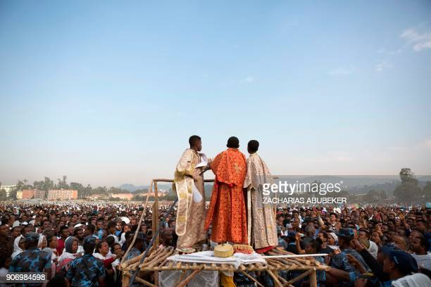 TOPSHOT Clergyboys spray blessed water onto patrons of the Ethiopian Orthodox church during the Timket an Epiphany festival in Addis Ababa on January...
