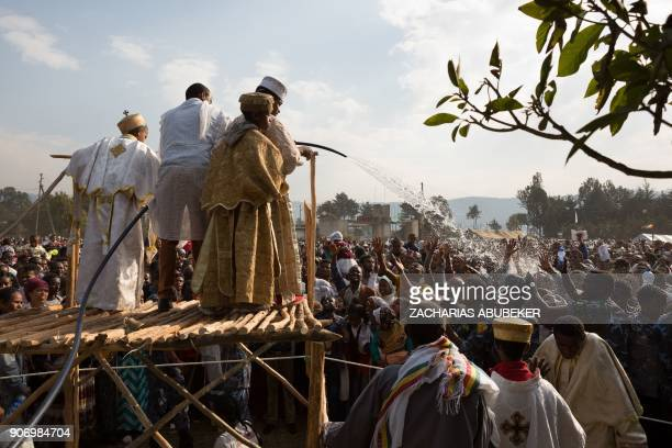 Clergyboys spray blessed water onto patrons of the Ethiopian Orthodox church during the Timket an Epiphany festival in Addis Ababa on January 19 2018...