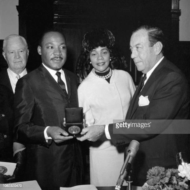 US clergyman and leader of the Movement against Racial Segregation Martin Luther King receives the NewYork medal of honor from NewYork's mayor Robert...