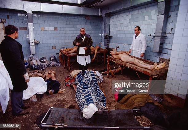 A clergyman gives a service in a makeshift morgue over the bodies of people killed during civil war in the former Soviet republic of Georgia Fighting...