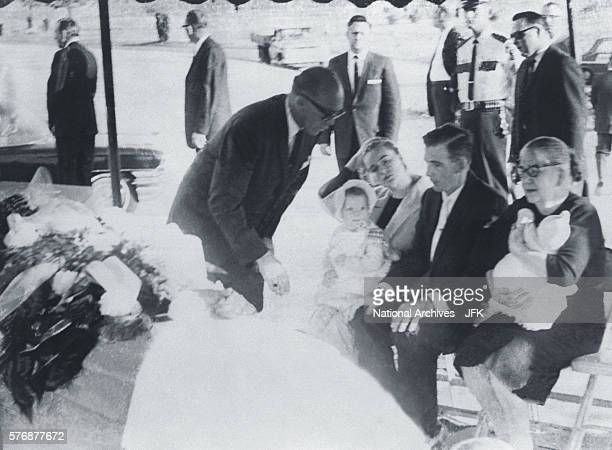 A clergyman speaks with family members of Lee Harvey Oswald at his funeral at Rose Hill Memorial Park in Fort Worth Texas Seated from left are Marina...