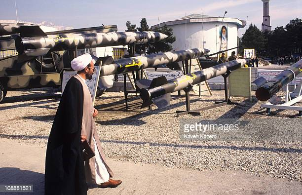 A clergyman walks past a missile display at on the grounds of the International Trade Fair Tehran Iran February 7 1999