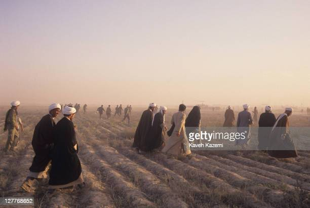 Clergymen arrive at a makeshift heliport before attending the funeral of Ayatollah Khomeini at Behesht Zahra cemetery, Tehran, Iran, 6th June 1989.
