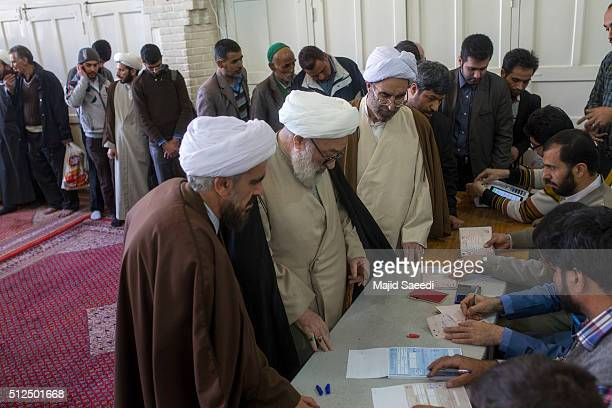 A cleric waits for registration during the parliamentary and Experts Assembly elections at a polling station on February 26 2016 in Qom 125...