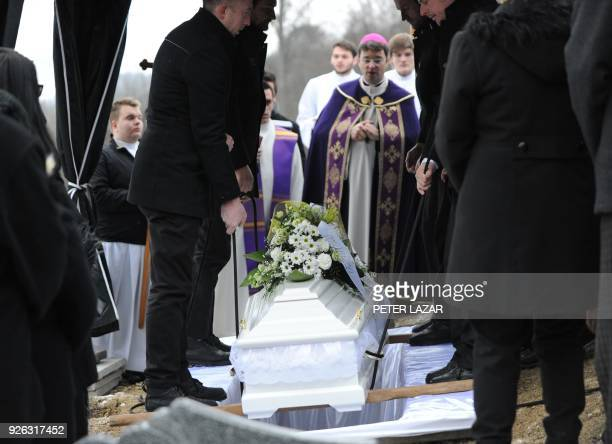 Clerics lead a religious service during the funeral of Martina Kusnirova who was murdered along with her fiance Slovak journalist Jan Kuciak at the...