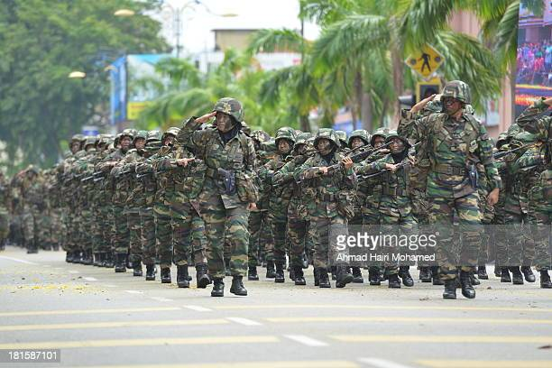CONTENT] clerics line independence august march Malaysia Kuantan white skull cap flag smile clean happy free peaceful green soldier army respect