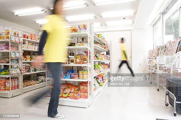 clerk at convenience store - convenience store stock photos and pictures