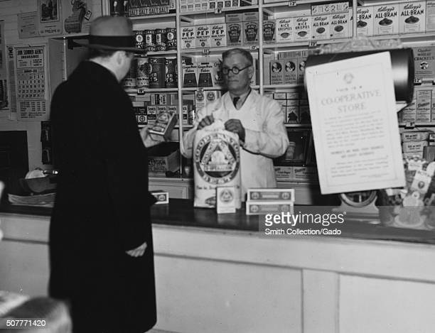 Clerk checks out a man at the United Cooperative store, Fitchburg, Massachusetts, 1936. From the New York Public Library. .